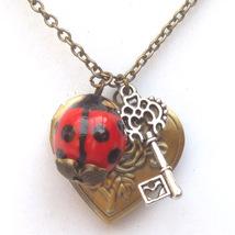 Antiqued Brass Key Porcelain Ladybug Locket Nec... - $13.99