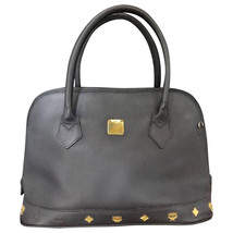Vintage MCM black bolide style bag with gold tone metal studded charms, ... - $263.00