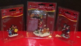 THREE (3) HOLIDAY TIME VILLAGE FIGURES-MINT IN ORIGINAL PACKAGING (#2) - $8.91