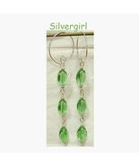 Sea green twisted glass beaded silver dangle earrings thumbtall