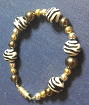 Zebra stripe bracelet with silver and gold accents - $15.00