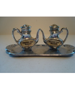 Souvenir, Wisconsin Dells coffee pot shape metal salt & pepper shaker set. - $6.00