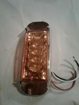 Orange led marker light. D586,024