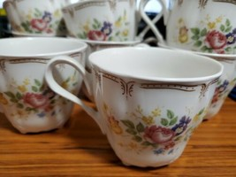 Nikko China Supreme Tea Cups Lot Of 8 Yellow Pink Purple Blue Floral Rosette 11 - $19.50