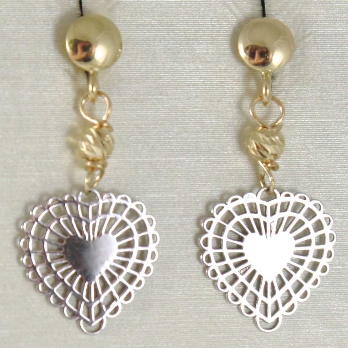 YELLOW GOLD EARRINGS AND WHITE 750 18K, HANGING, WITH SPHERES AND HEARTS WORKED
