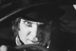A Clockwork Orange Malcolm Mcdowell menacing behind car wheel 18x24 Poster - $23.99