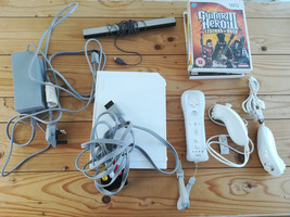 Nintendo Wii Bundle With Console, Controller, Accessories & 4 Games - $39.44