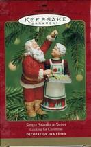 2001 SANTA SNEAKS A SWEET Box Hallmark Christmas Ornament Cooking for Christmas - $9.79
