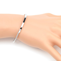 UE- Stylish Silver Tone Designer Twisted Bangle Bracelet With Trendy Bar... - $13.99
