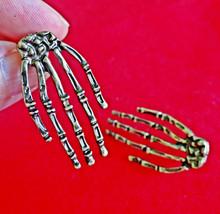 """Gold tone 1.5"""" pierced skeletal hands earrings ... - $15.00"""