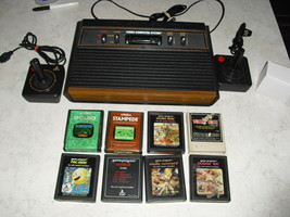 Atari 2600 4 SWITCH with joysticks, adapter, 8 GAMES  pac-man, enduro, stampede - $148.49