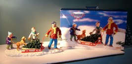 """Bringing Home The Tree"" Lemax Memory Makers 1997 #77011 9"" Inches - $24.74"