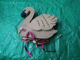 Christmas Ornament 1988 brown wood swan w hanging cord - $20.00