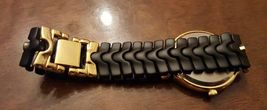 VINTAGE THE ORYX QUARTZ GOLD & BLACK FLEX BAND WRIST WATCH JAPANESE MOVEMENT image 8