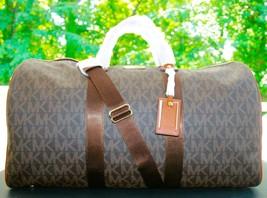 New MICHAEL KORS Signature XL Travel Duffle Bag weekender $458 - $4.103,27 MXN