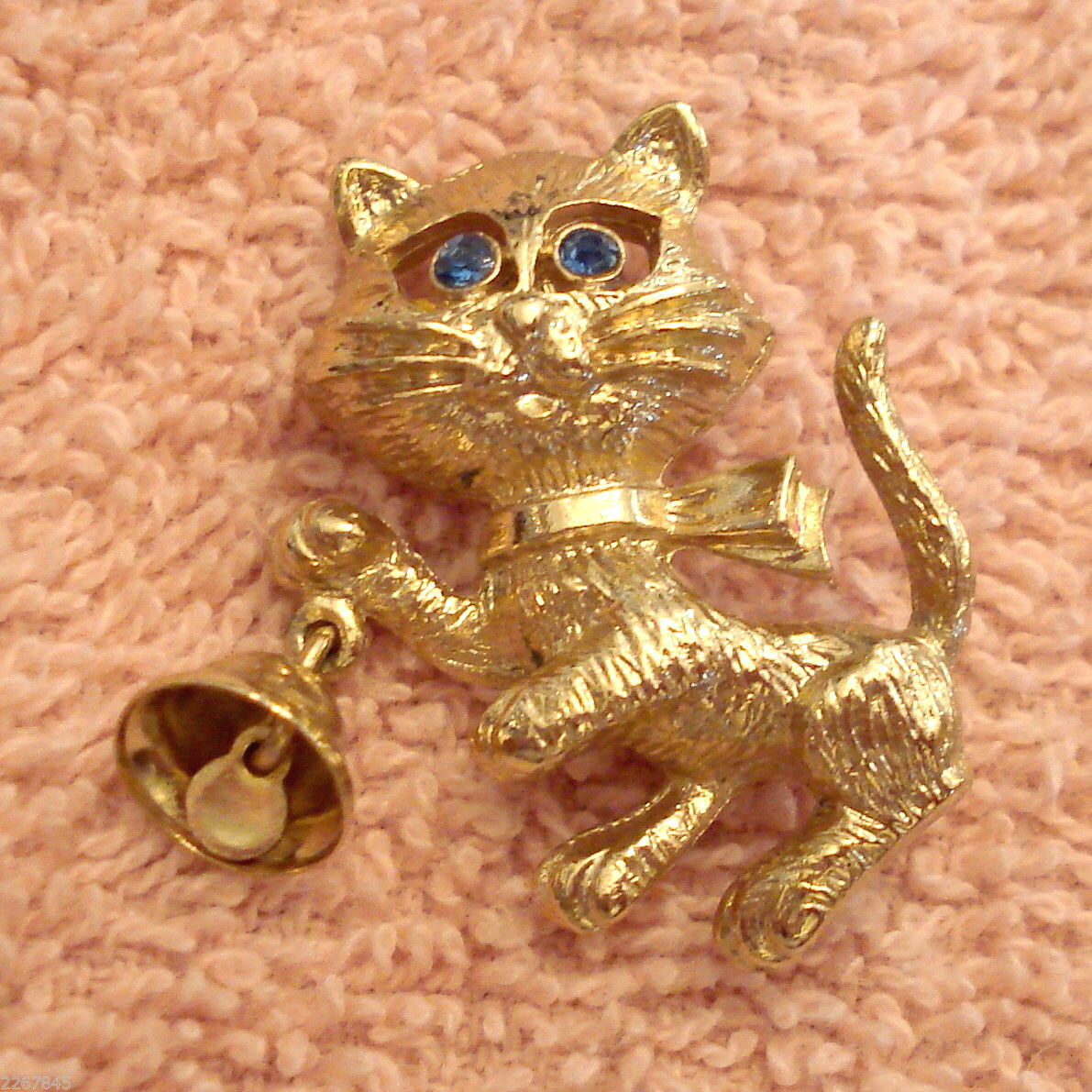 Primary image for Avon Frisky Kitty Pin Rhinestone Eyes Figural CAT Brooch Bell Rings VTG 1970s