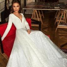 Booma Lace Long Sleeve V-neck Backless Satin Wedding Gown Plus Sizes image 5