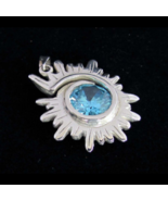Spiral shaped Sterling silver Pendant with a Stunning Light Blue CZ high... - $48.00