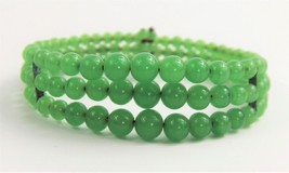 ESTATE VINTAGE Jewelry GREEN GRADUATED GLASS BEAD TRIPLE ROW COIL BRACELET - $40.00