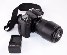 Nikon D7000 body and 70-300mm kit lense and charger. - $294.53