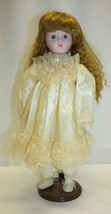 """Vintage 15-1/2"""" Porcelain Doll Dark Brown Hair Green Eyes Unbranded  - $19.79"""