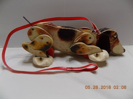 1961 Snoopy Pull Toy with Red  Plastic Leash  Wood Fisher Price.(r2-3) - $18.58