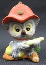 Vintage ceramic Japan figurine Owl Firefighter w helmet and hose - $19.00