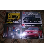 3 brand new model cars packaged all together brand new - $77.99