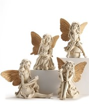 Set of 4  Medium Fairy Design Figurines - Cream With Gold Wing Accents - $128.69