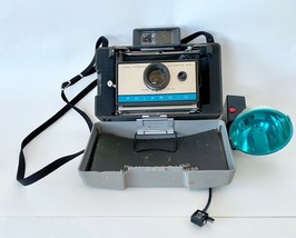 Polaroid Camera, 210 w Light Attachment, Color Clip, Instructions - $48.97