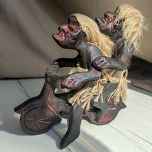 Wooden figurine of Asmat bikers on a motorcycle from a mangrove tree. - $38.00