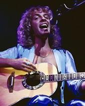Peter Frampton 1970's concert pose in open blue shirt playing guitar singing - $69.99