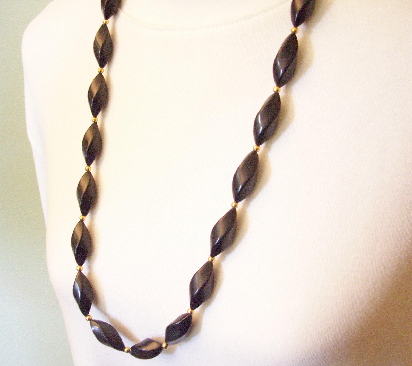 "NAPIER Jet BLACK Oval Twist Beads Strand Necklace Gold Spacers 32"" Vintage"