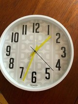 """Mainstays Patterned 11.5"""" wall clock with AA battery Grey, white, yellow... - $9.99"""