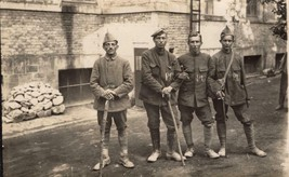 World War 1 real photo post card: 4 Prisoners of War (German soldiers?) - $31.68