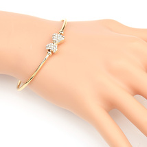 UE- Trendy Gold Tone Designer Bangle Bracelet With Swarovski Style Crystal Bow  - $18.99