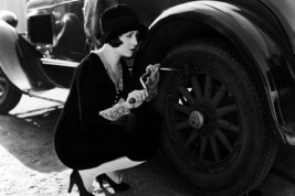 Dorothy Sebastian Changing Tire On Vintage Car 24x18 Poster - $23.99