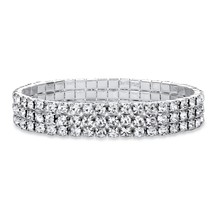 "Round Crystal Silvertone Triple-Row Stretch Bracelet 7"" - $17.99"