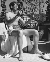 Jean-Paul Belmondo cool pose in swimwear seated on chair 1960's 16x20 Canvas Gic - $69.99