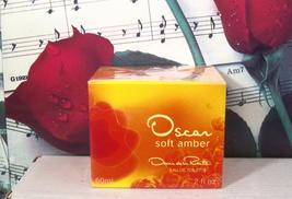 Oscar Soft Amber EDT Spray 2.0 FL. OZ. By Oscar De La Renta - $59.99