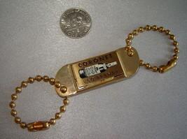 Vintage CORONET VSQ BRANDY Small Gold Keychain Clip Advertising Tag - $9.70