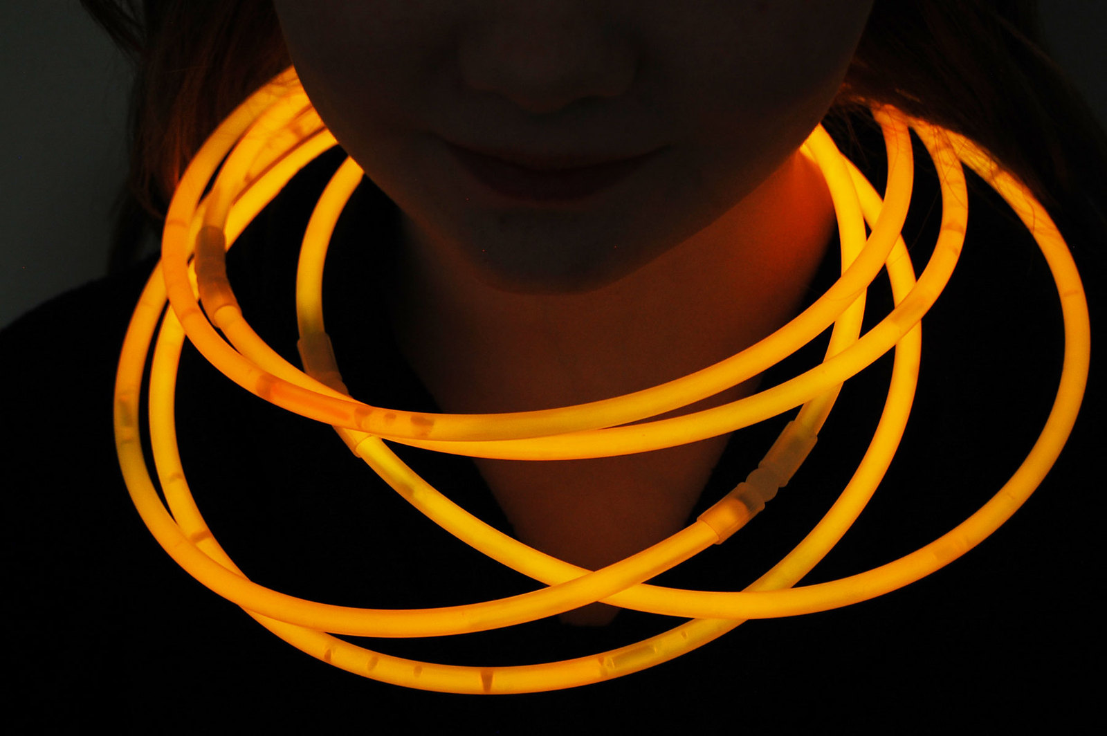 "Primary image for 50 22"" Premium Jumbo Orange Glow Stick Necklaces Preattached Connectors"