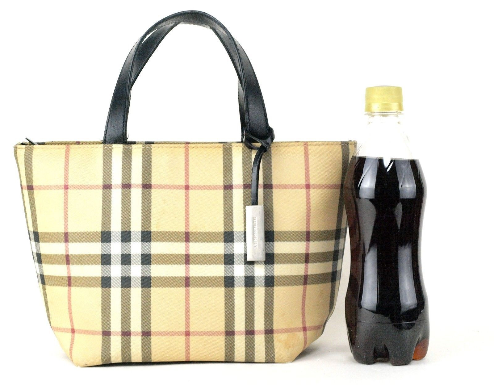 0f4de9771a02 Authentic Burberry London Nova Check PVC and 39 similar items. 57
