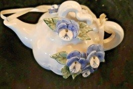 Blue and white teapot ornament with applied pansys - $4.97