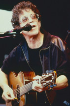 Lou Reed and Lou Reed in concert pose playing guitar 18x24 Poster - $23.99