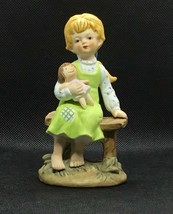 Vintage Porcelain Girl Sitting on Bench Hold Teddy Bear - $7.60