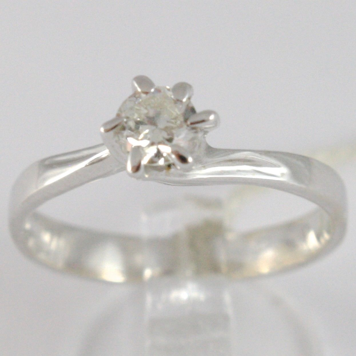 WHITE GOLD RING 750 18K, SOLITAIRE, STEM CRISS CROSSED, DIAMOND CARAT 0.32