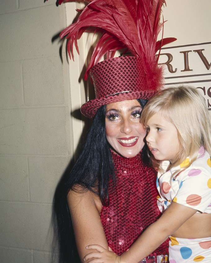 Primary image for Cher in red sequined outfit and hat with daughter Chastity 1970 16x20 Canvas