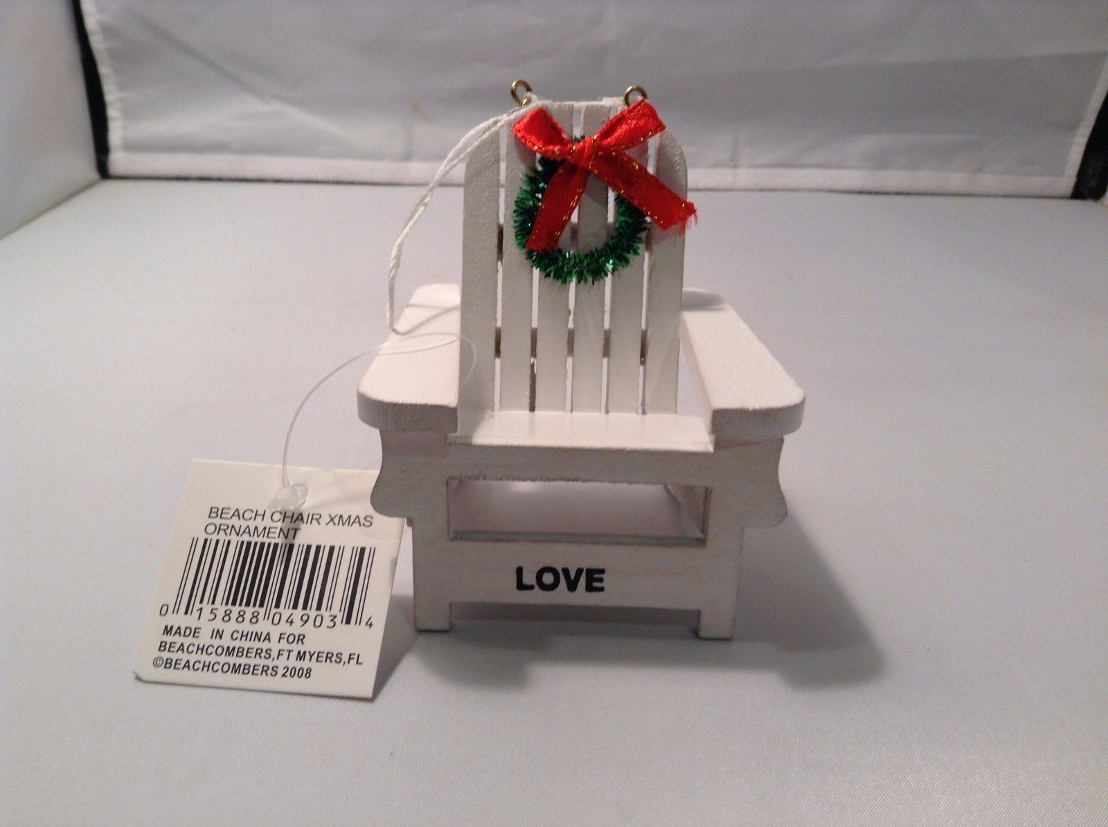 White Adirondack beach chair ornament with holiday greens wreath and LOVE