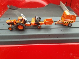 Toy Tonka Tractor and 2 Attachments - $39.99
